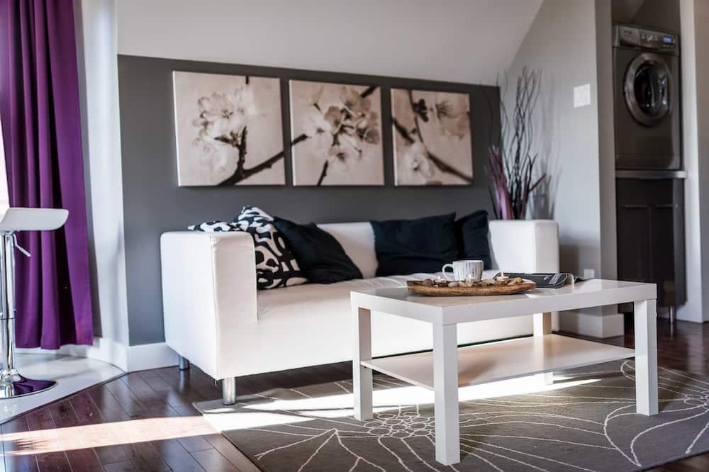 جناح ديلوكس - سرير كبير - غرفة معيشة