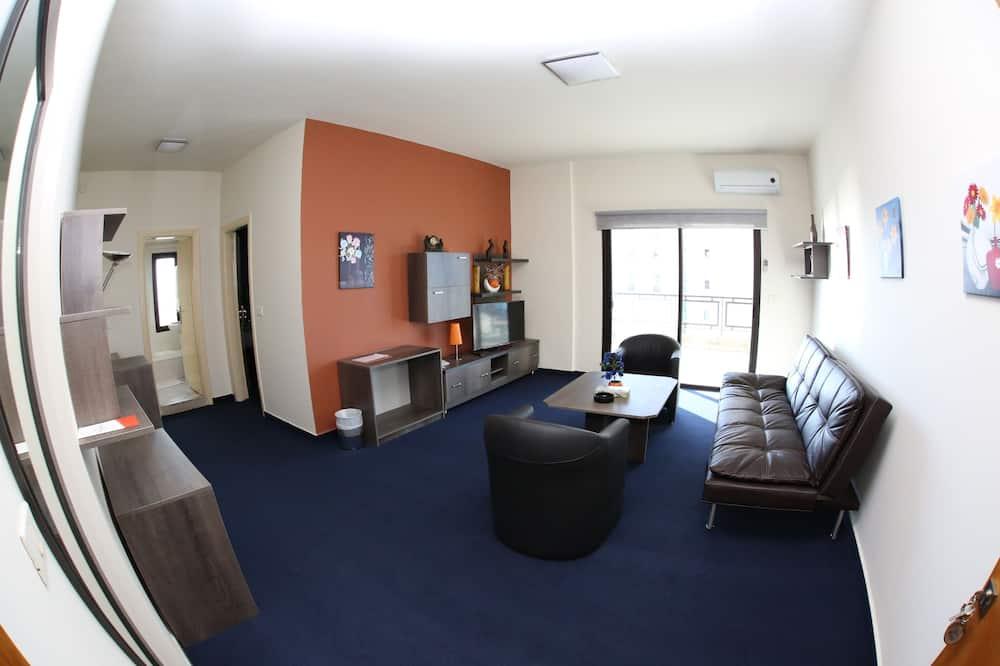 Улучшенный люкс, вид на океан - Гостиная