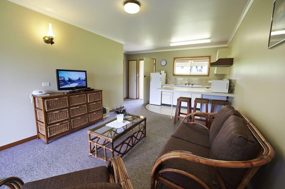 Chambre Triple Standard, 1 chambre, balcon, rez-de-chaussée - Coin séjour