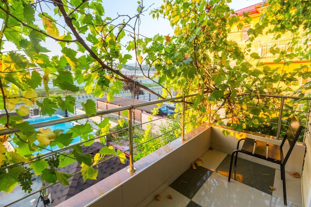 Apartamento Comfort, 2 Quartos, Kitchenette - Varanda
