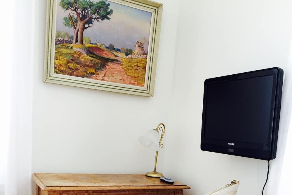 Jednolůžkový pokoj - Obývací prostor