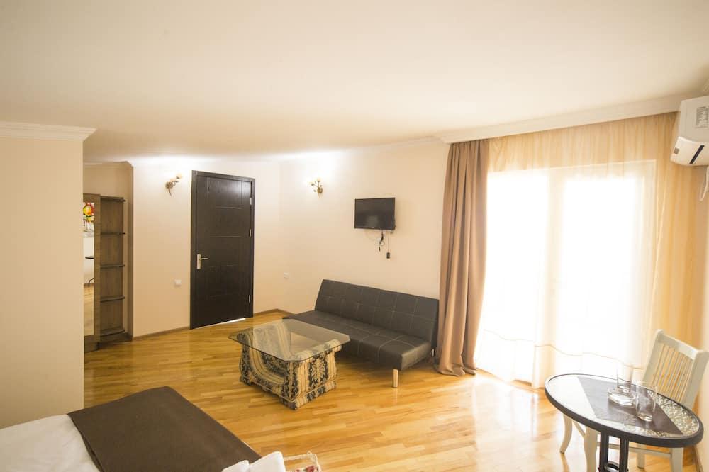 Deluxe-Doppelzimmer, Balkon - Wohnbereich