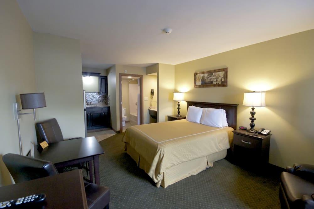 חדר אקונומי, מיטת קווין, מטבחון - חדר אורחים