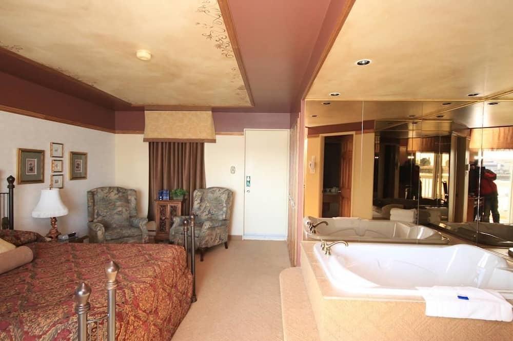 Номер «Делюкс», 1 двуспальная кровать «Квин-сайз», гидромассажная ванна - Зона гостиной
