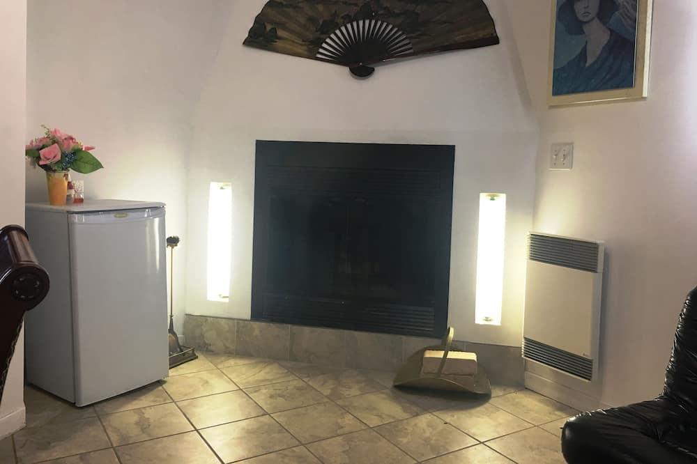 Suite Deluxe, 2 camas dobles, bañera de hidromasaje (Fireplace) - Sala de estar