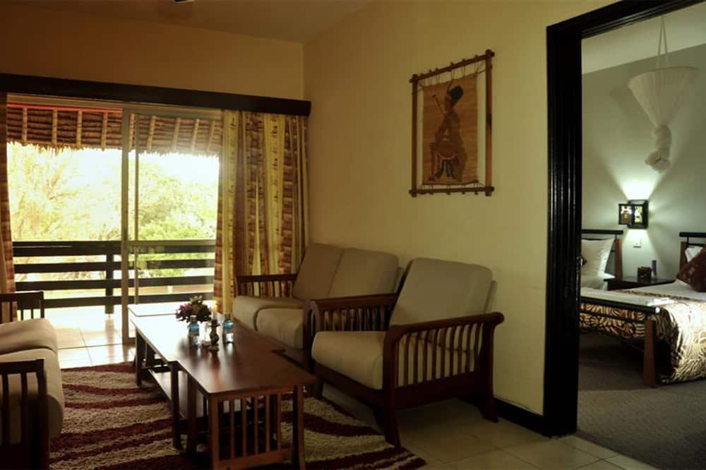 Standard Double Room, River View, Garden Area - Living Area