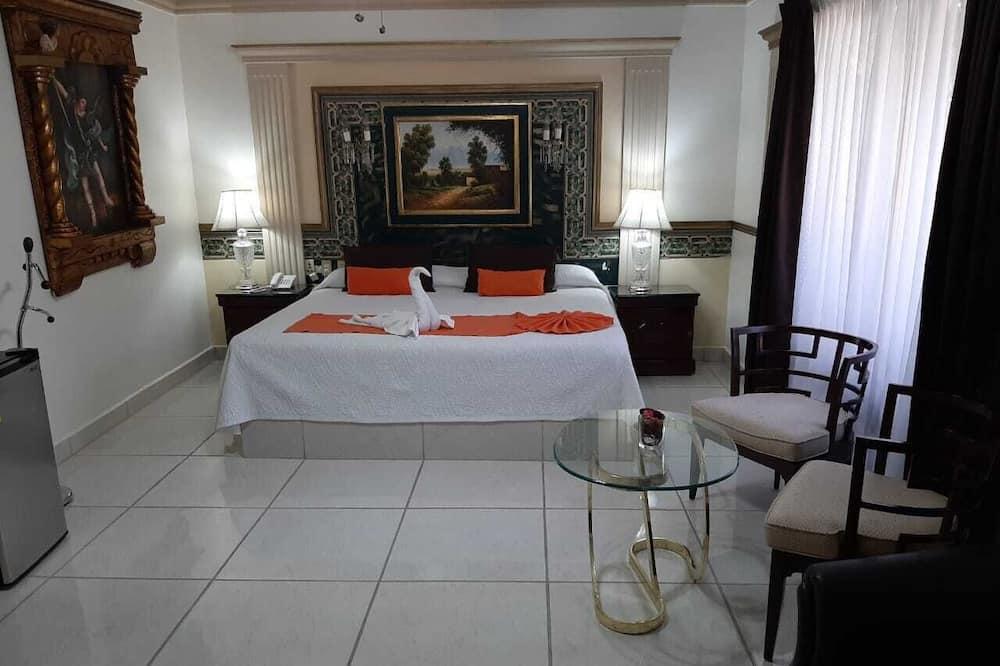 جناح - سرير ملكي - ثلاجة - غرفة نزلاء