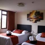 Deluxe Triple Room, 2 Queen Beds, Garden Area - Guest Room