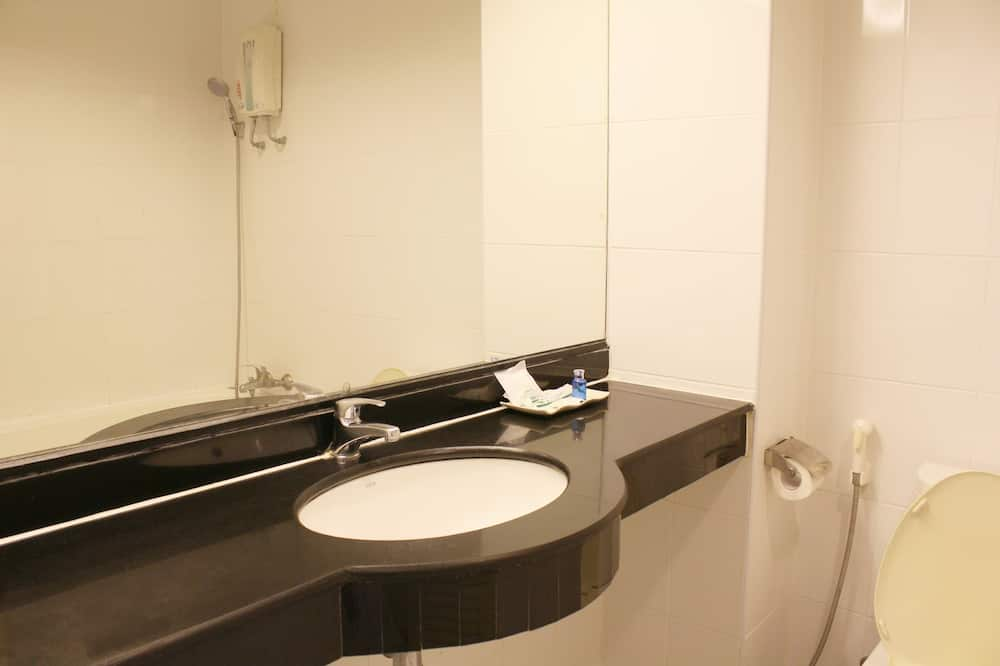 Deluxe Room - Waschbecken im Bad