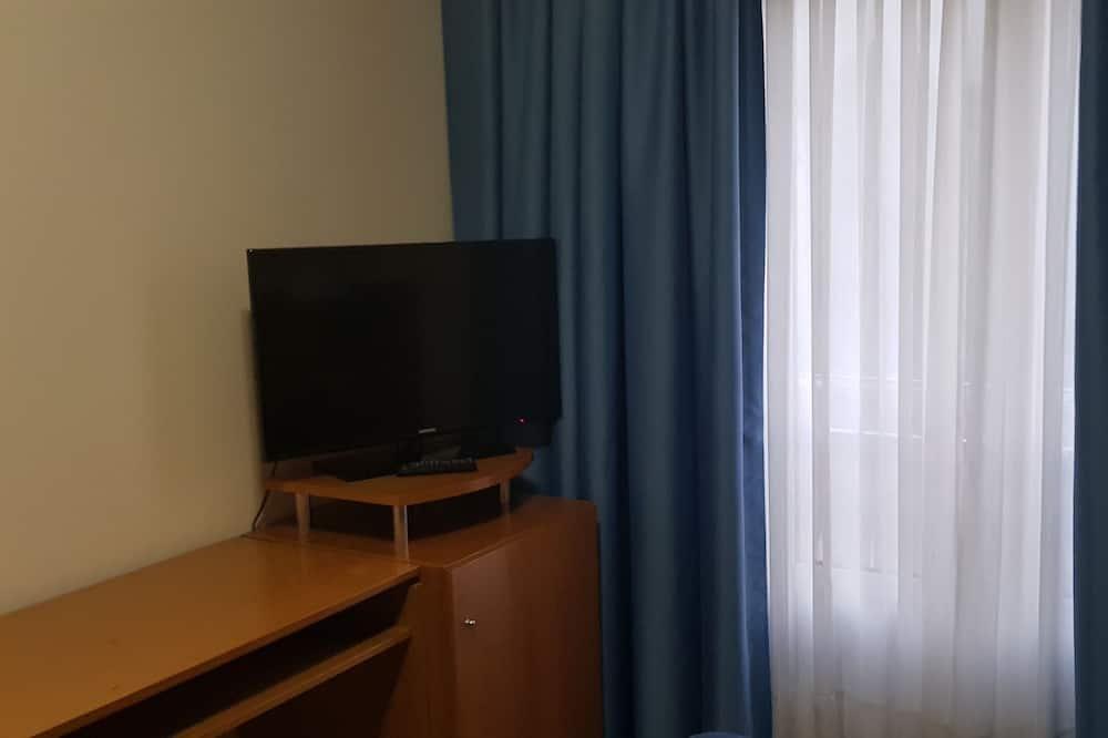 Chambre Double pour 1 personne - Coin séjour