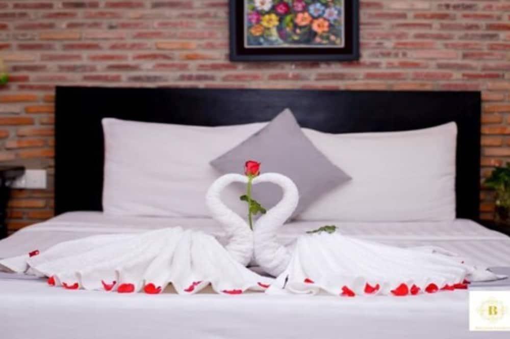 ห้องดีลักซ์สวีท, เตียงคิงไซส์ 1 เตียง, วิวเมือง, ห้องมุม - วิวเมือง