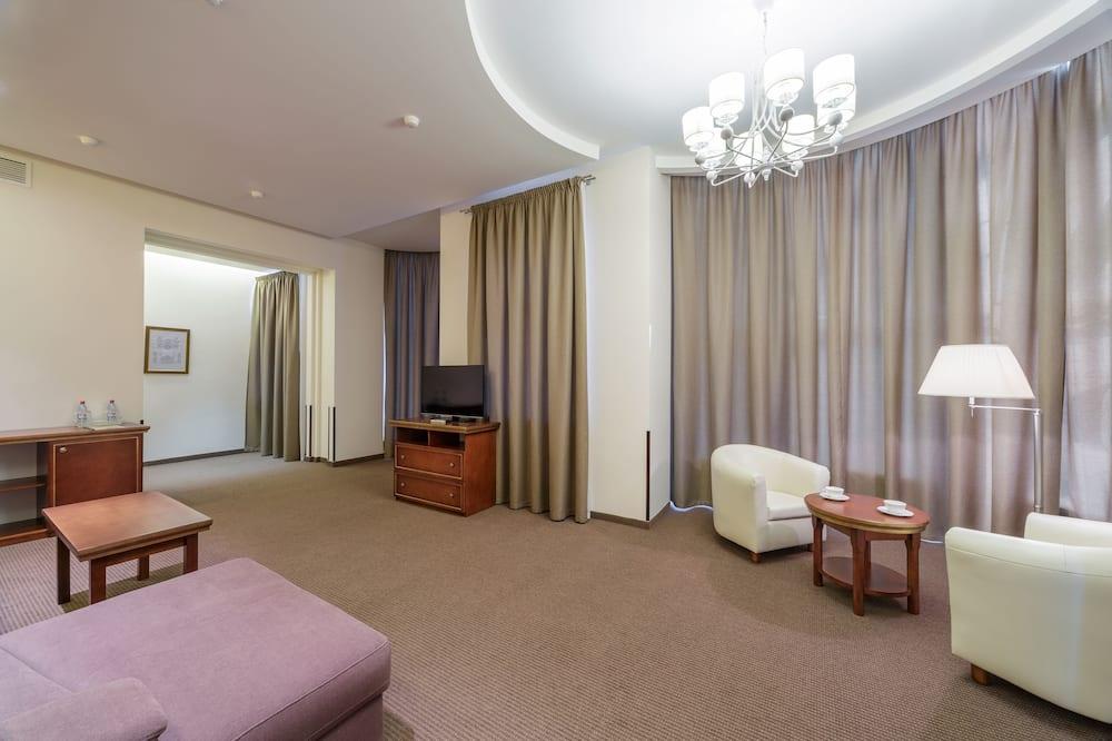 Luxe suite, 1 kingsize bed met slaapbank, Uitzicht op de stad - Woonkamer