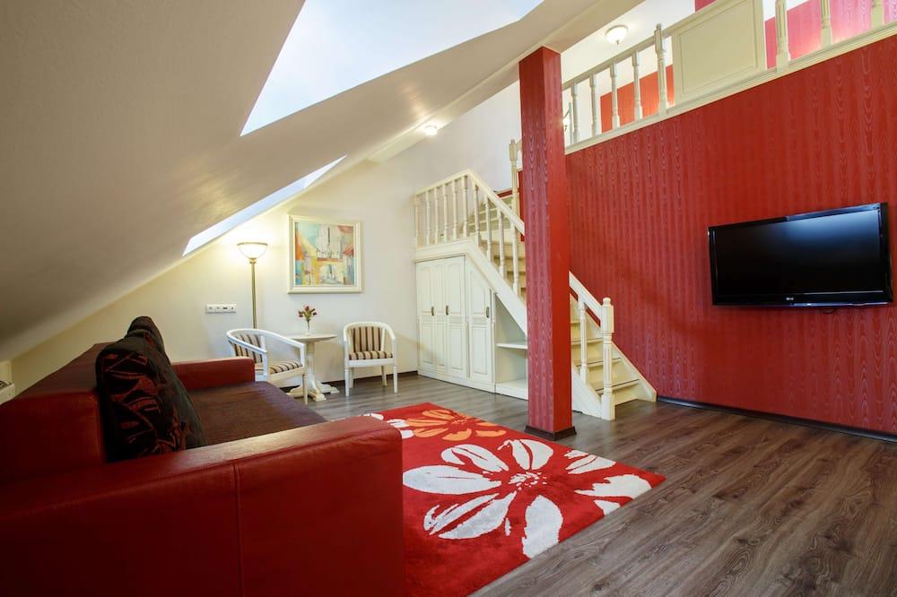 ห้องสวีท, เตียงคิงไซส์ 1 เตียง (Duplex) - พื้นที่นั่งเล่น