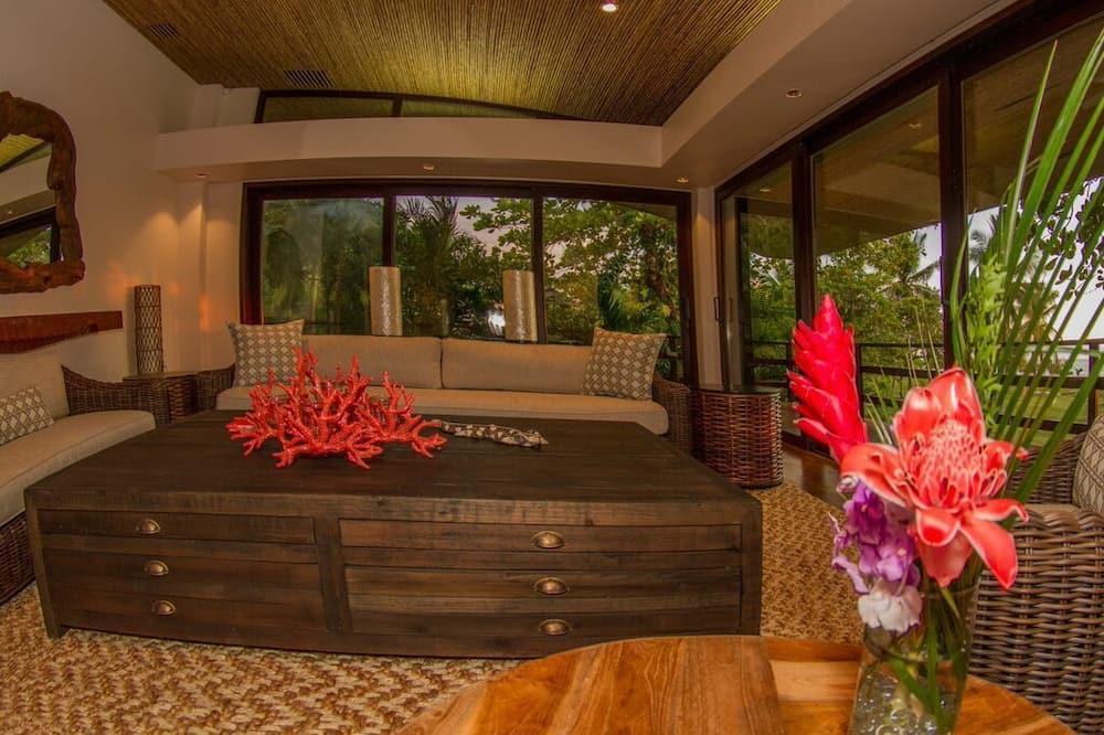 Suite Deluxe, 1 cama King size, vista al mar - Sala de estar