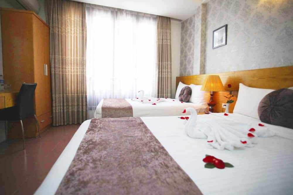 Deluxe-Dreibettzimmer, Stadtblick - Zimmer