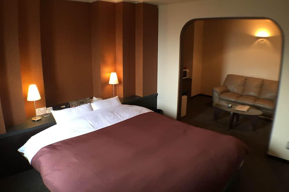 Двухместный номер «Делюкс» с 1 двуспальной кроватью, для некурящих (No Housekeeping) - Гостиная