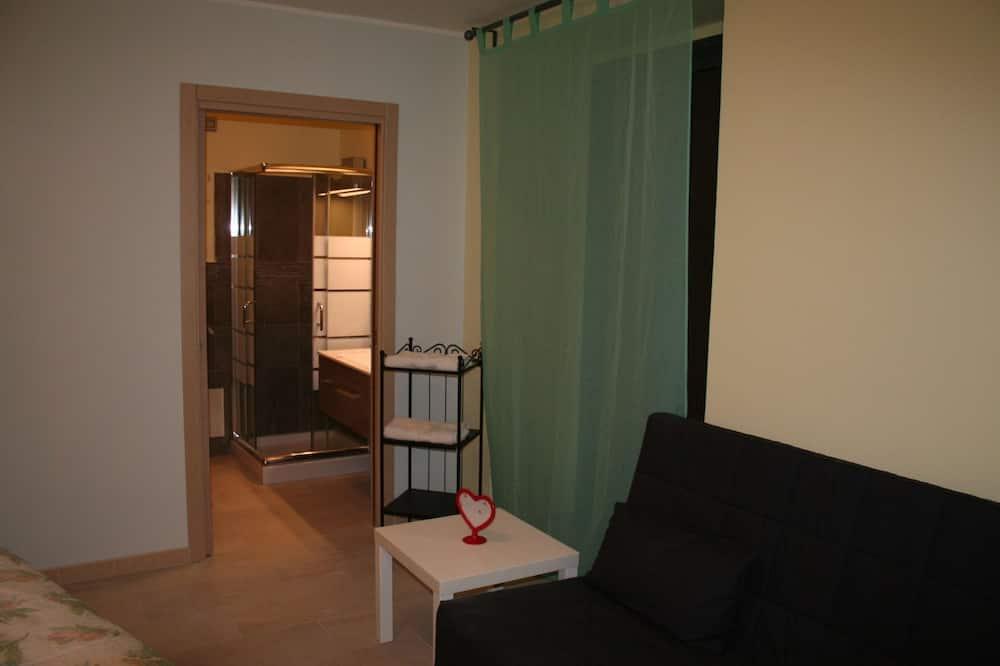 Pokoj Superior s dvojlůžkem, dvojlůžko a rozkládací pohovka, soukromá koupelna, Executive patro - Obývací prostor