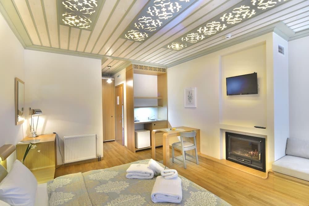 Superior-Suite, Kamin - Kochnische im Zimmer