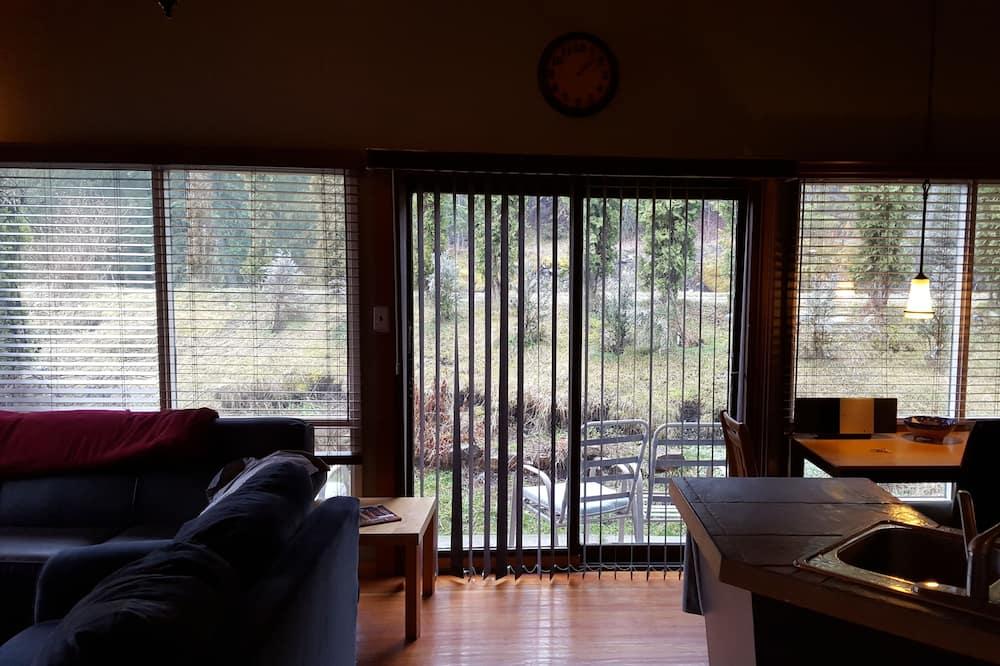 Casa de Campo Comfort, várias camas, Vista Rio - Área de Estar