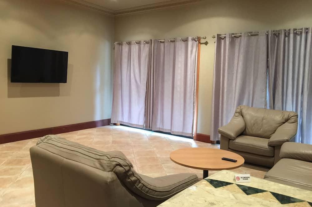 Căn hộ Deluxe, 1 phòng ngủ, Quang cảnh núi - Phòng khách
