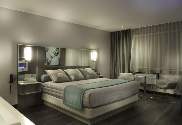 Motel Idéal Ste-Rose, Laval, Suite Superior, 1 cama king-size (Suite 412), Quarto