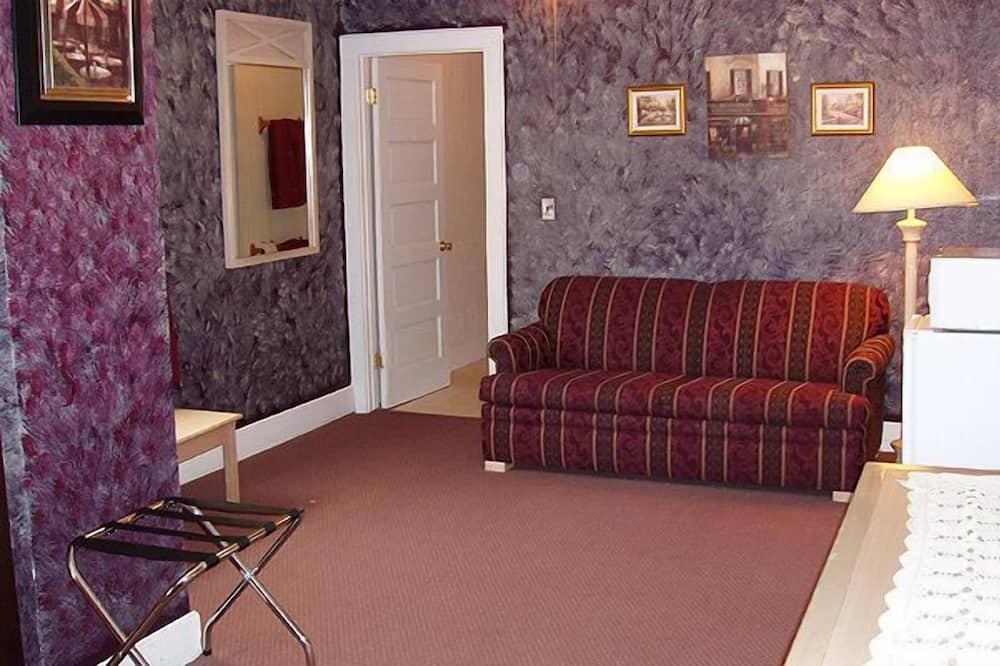 Suite, 1 kingsize bed met slaapbank - Woonruimte