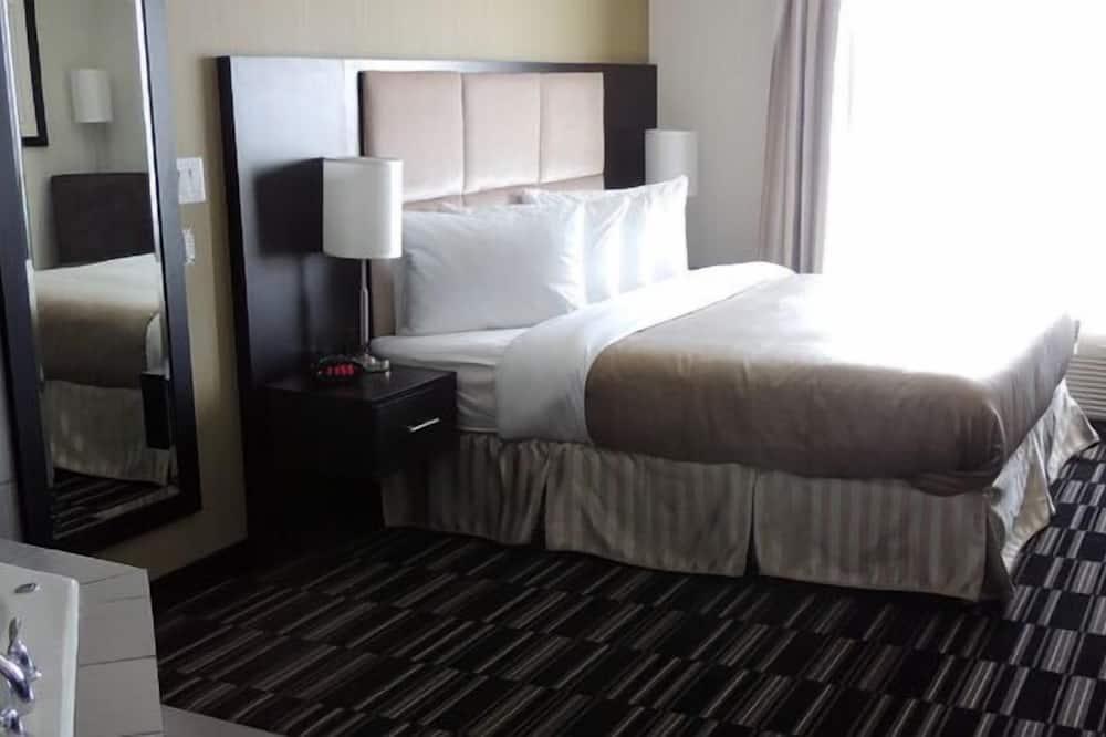 غرفة ديلوكس - سرير ملكي - بحوض استحمام بنظام دفع المياه - مغطس بمضخات للمياه
