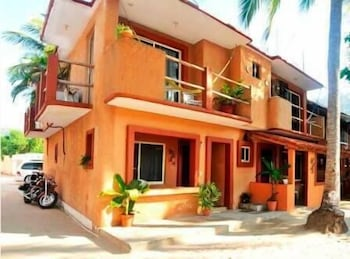 Picture of Suites Playa La Ropa Hotel El Pirata in Zihuatanejo