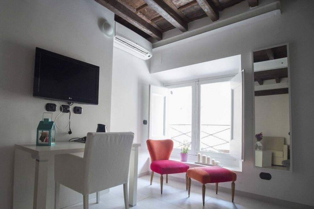جناح - سرير كبير مع أريكة سرير - في مبنى ملحق (Specchi) - منطقة المعيشة