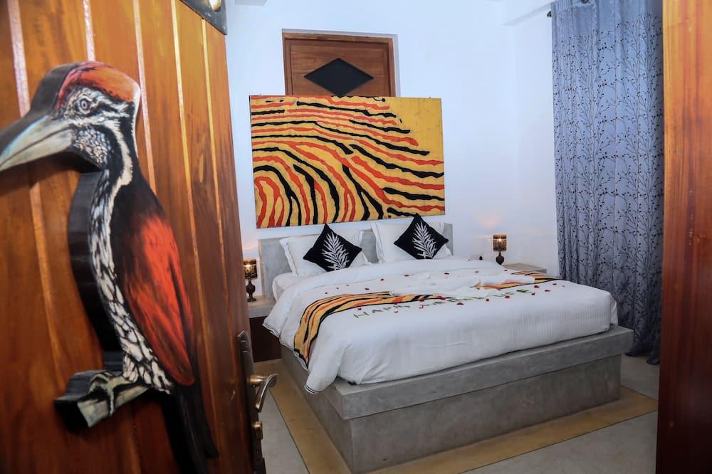Dvojlôžková izba typu Deluxe - Obývačka