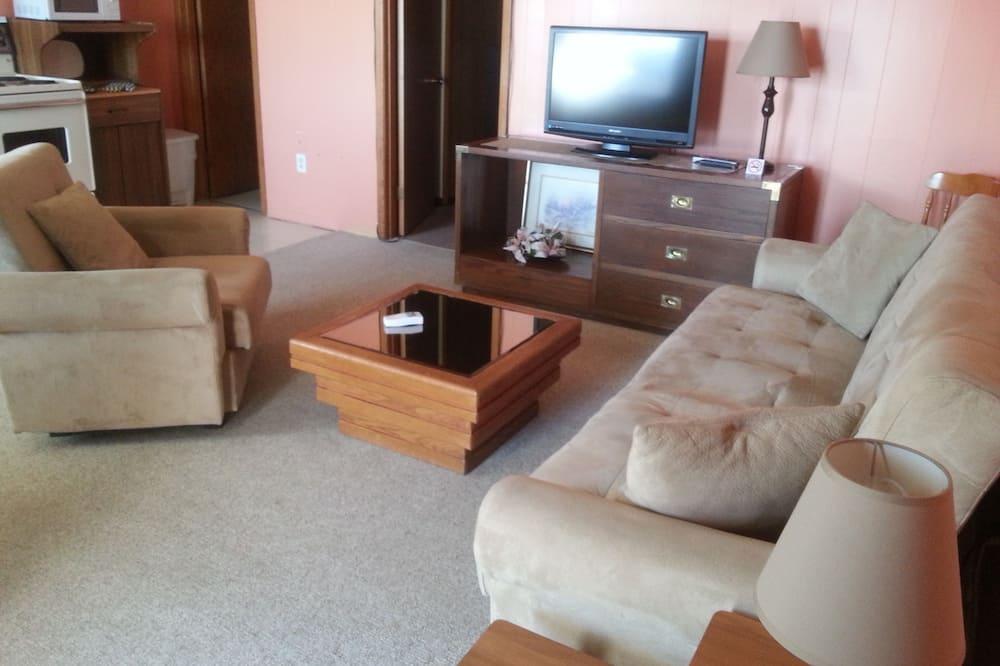 ห้องสวีท, เตียงควีนไซส์ 1 เตียง และโซฟาเบด - พื้นที่นั่งเล่น