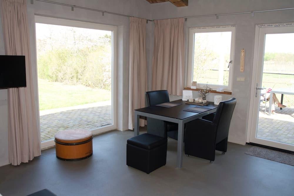 Studio có tầm nhìn toàn cảnh, 1 giường cỡ queen, Quang cảnh vườn (Framboos) - Khu phòng khách