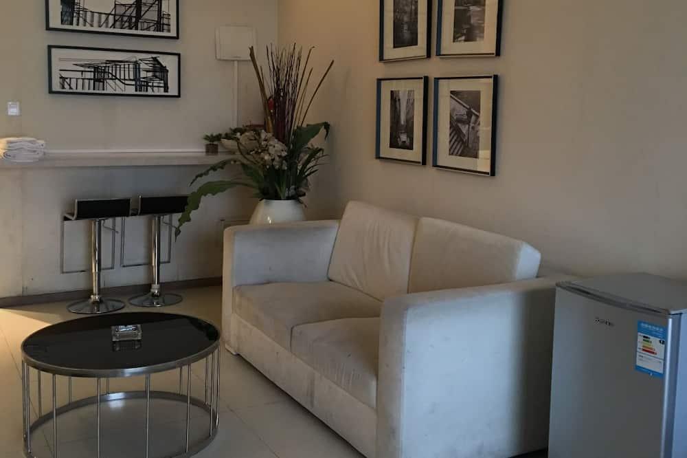 Habitación triple Deluxe - Sala de estar