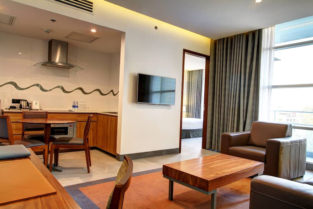 Deluxe suite, 1 spavaća soba, pogled na grad, kut zgrade - Dnevni boravak