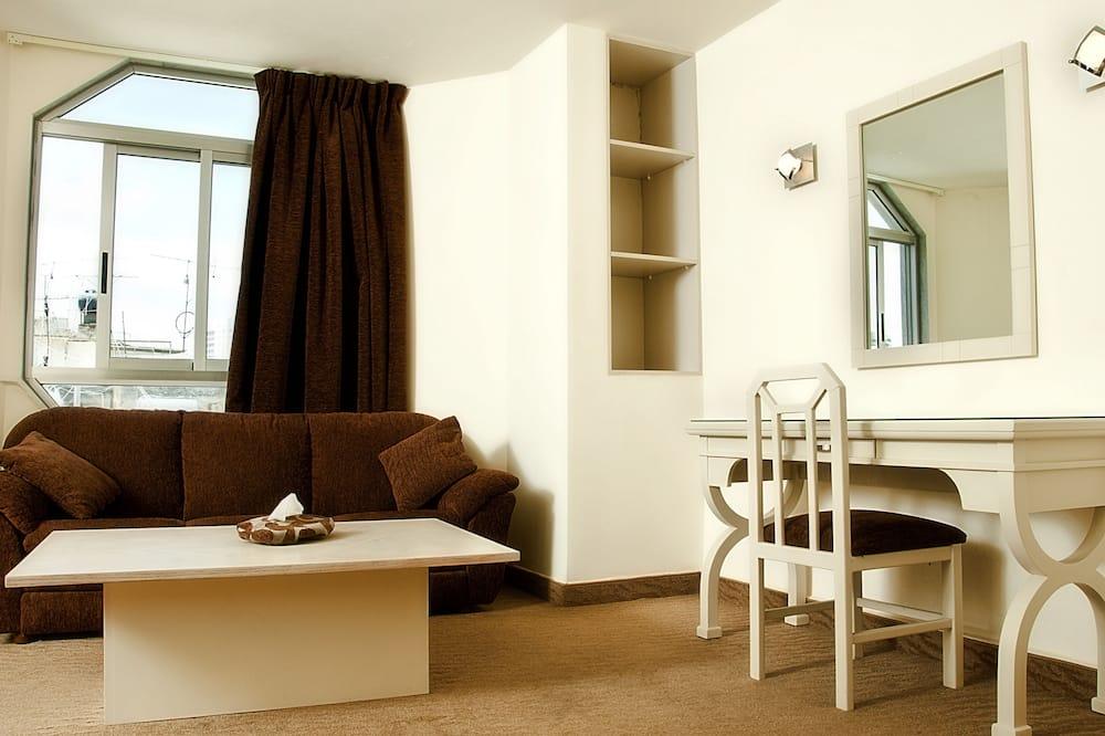 Zīmola luksusa numurs, 1 divguļamā karaļa gulta, virtuvīte - Dzīvojamā zona