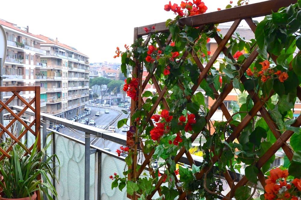 Chambre Deluxe, vue ville - Balcon