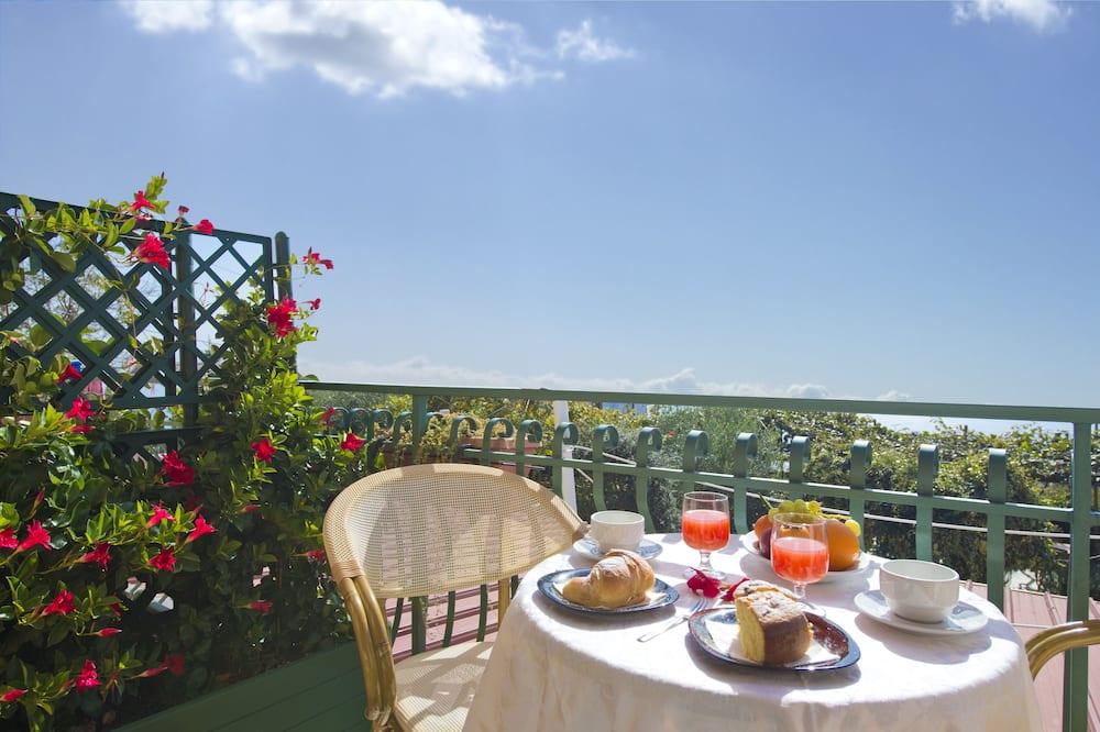 Quadruple Room, Sea View - Balcony
