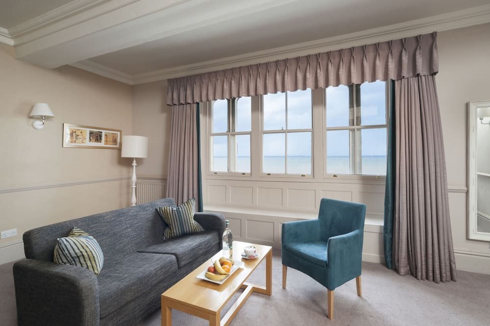 Habitación doble Premier, vista al mar - Sala de estar