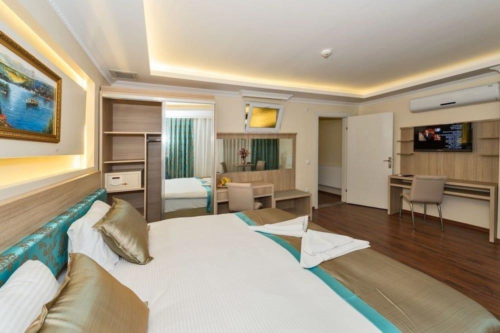 Apartamento Deluxe, bañera de hidromasaje - Habitación