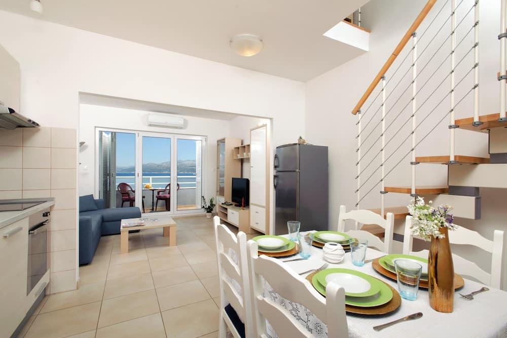 Dzīvokļnumurs, viena guļamistaba, balkons, skats uz jūru - Numura ēdamzona