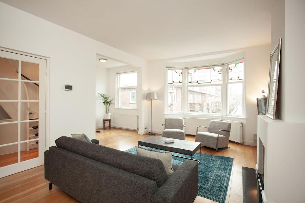 Liukso klasės apartamentai, 3 miegamieji - Svetainės zona