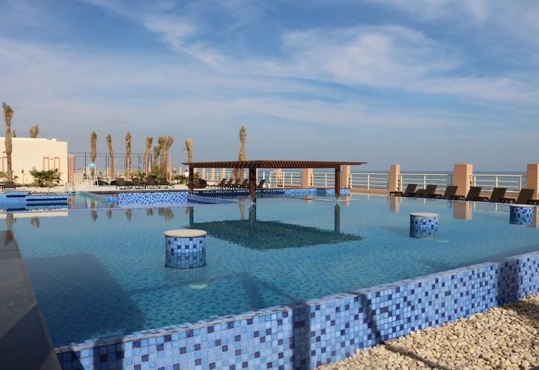 Radisson Blu Hotel, Sohar, Sohar, Cascada en la piscina