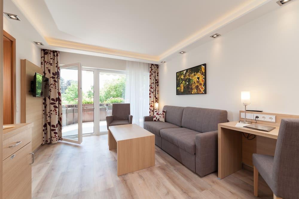 Suite Deluxe, no fumadores, vistas al jardín - Sala de estar