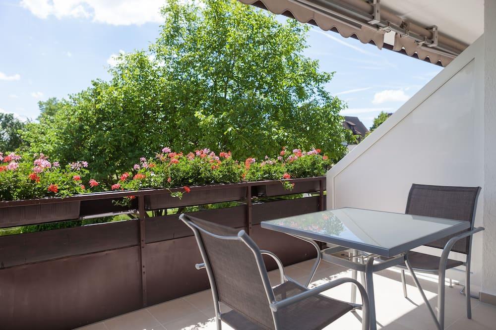 Habitación Deluxe doble, 1 cama de matrimonio grande, no fumadores, vistas al jardín - Balcón