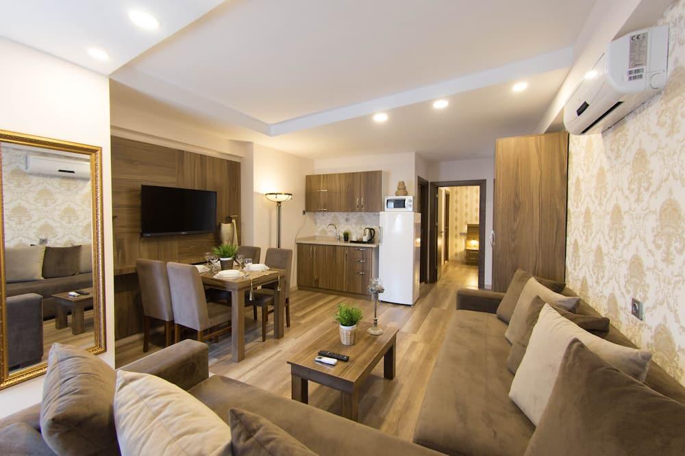 Deluxe Two-Bedroom Suite - Living Room