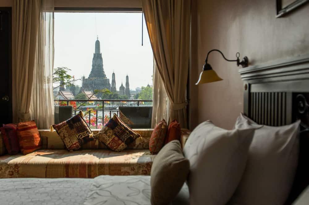 ห้องดีลักซ์, เตียงใหญ่ 1 เตียง, ระเบียง, วิวแม่น้ำ - ภาพเด่น