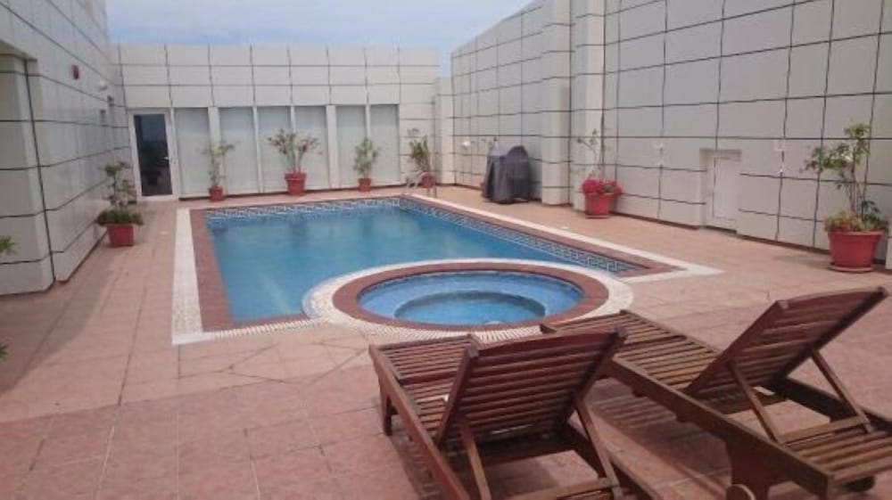Aaa Suites By Homes Manama Pool