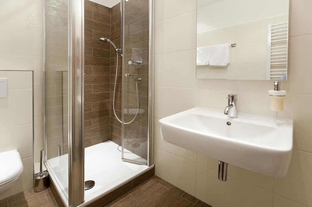 Comfort szoba, kilátással a kertre - Fürdőszoba