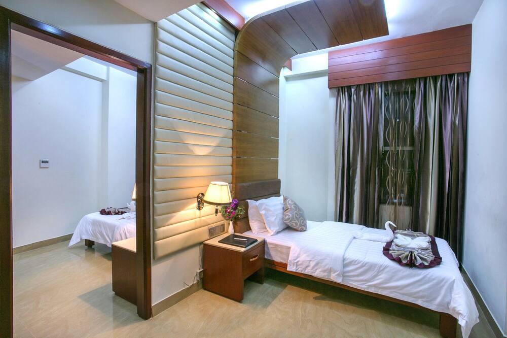 Luksusa ģimenes numurs, divas guļamistabas, stūris - Viesu numurs