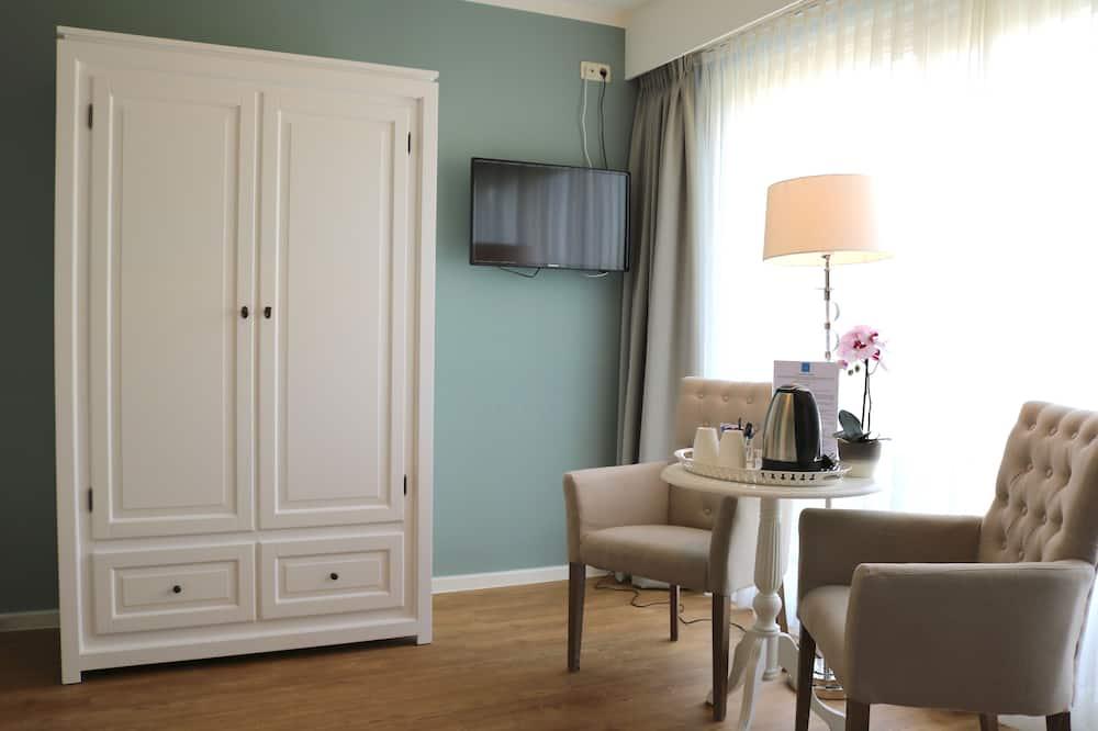 Comfort Double Room, Garden View - Living Area